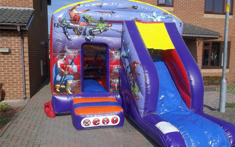 super hero bouncy castle super slide
